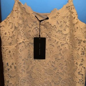 White lace dress new with tags . Zara